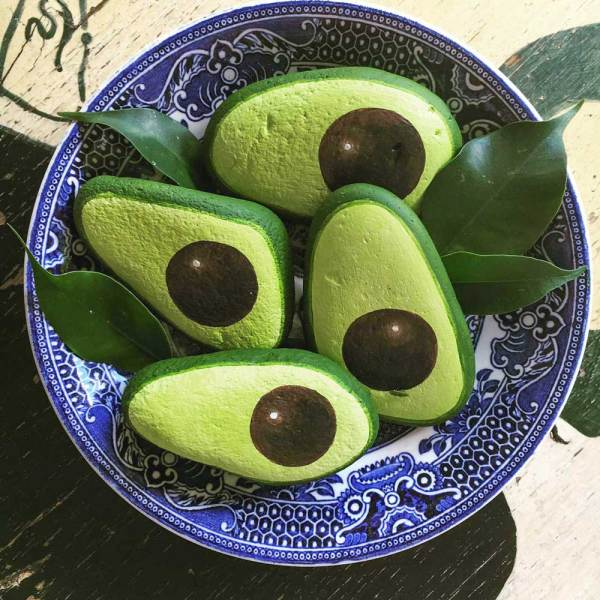 Painted avocado rocks in a bowl