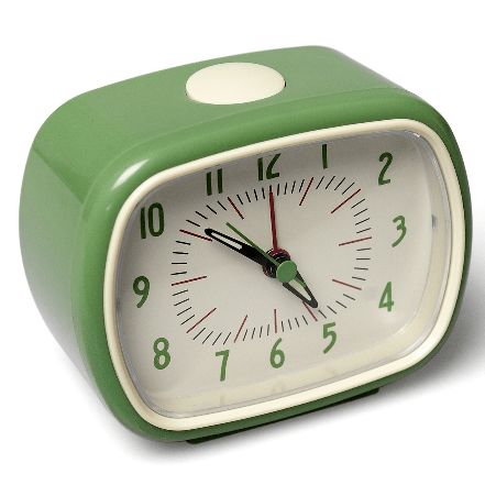 Image of a retro green alarm clock. Compact, battery powered.