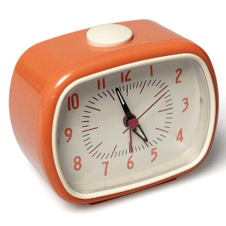 Image of a retro orange alarm clock. Battery operated.