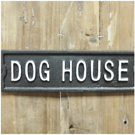 Image of a dog house cast iron sign