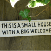 Image of a cast iron wall plaques small house