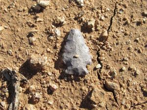 native american indian arrowhead on desert floor