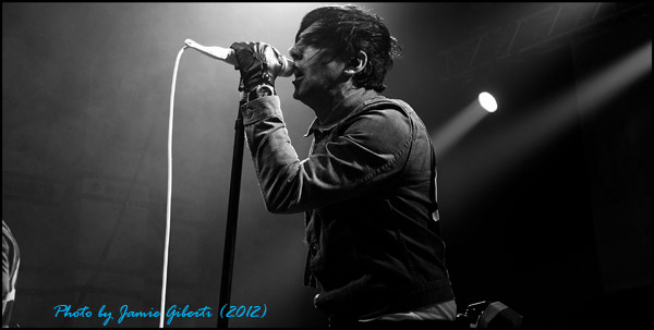 Ian Watkins of Lostprophets on stage at The Cambridge Corn Exchange (2012)