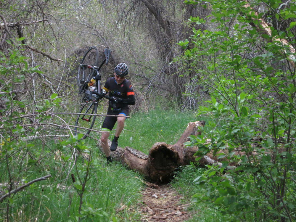 Patrick hopping natural barriers during their recon ride (a la 1970s cyclocross). Photo credit - Matt Deviney