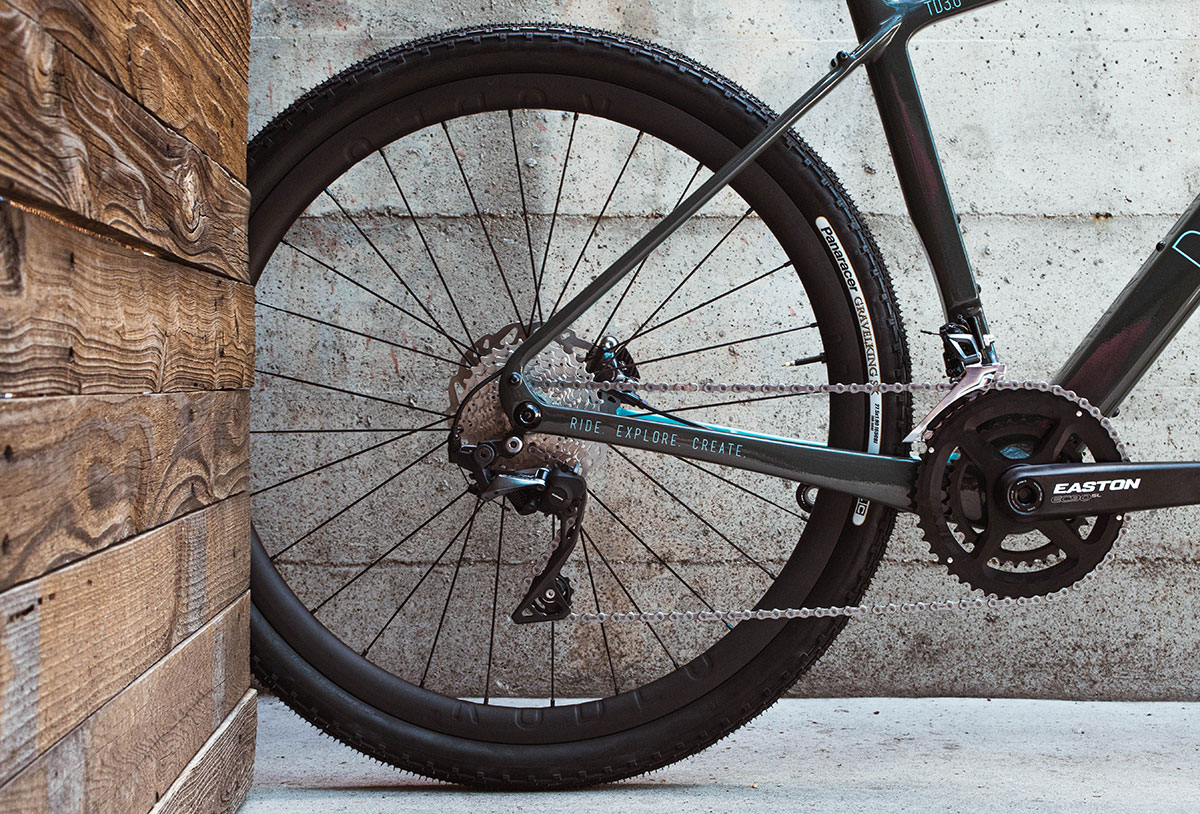 Photograph of a wheel in a gravel bike. Shows spacing of 650b tires in this frame