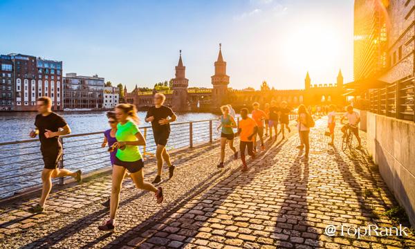 Marathon runners along canal image.
