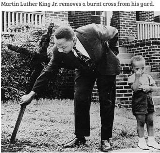 Martin Luther King removes burnt cross
