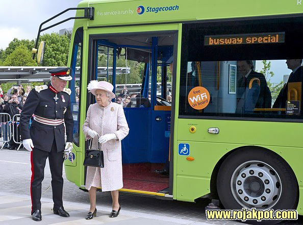 Queen Elizabeth and the Duke of Edinburgh arrives by guided bus at the Medical Research Council, Cambridge