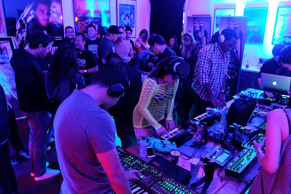 Attendees exploring the latest Roland gear at Six01 Studio on #909day.