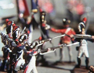 Model British infantry soldiers open fire on the French, in the opening scene of the 1977 remake of The Four Feathers. From https://wargamingmiscellanybackup.wordpress.com/category/wargames-on-film-and-tv/