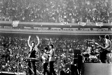 Image result for 1965 – The Beatles play to nearly 60,000 fans at Shea Stadium in New York City, an event later regarded as the birth of stadium rock