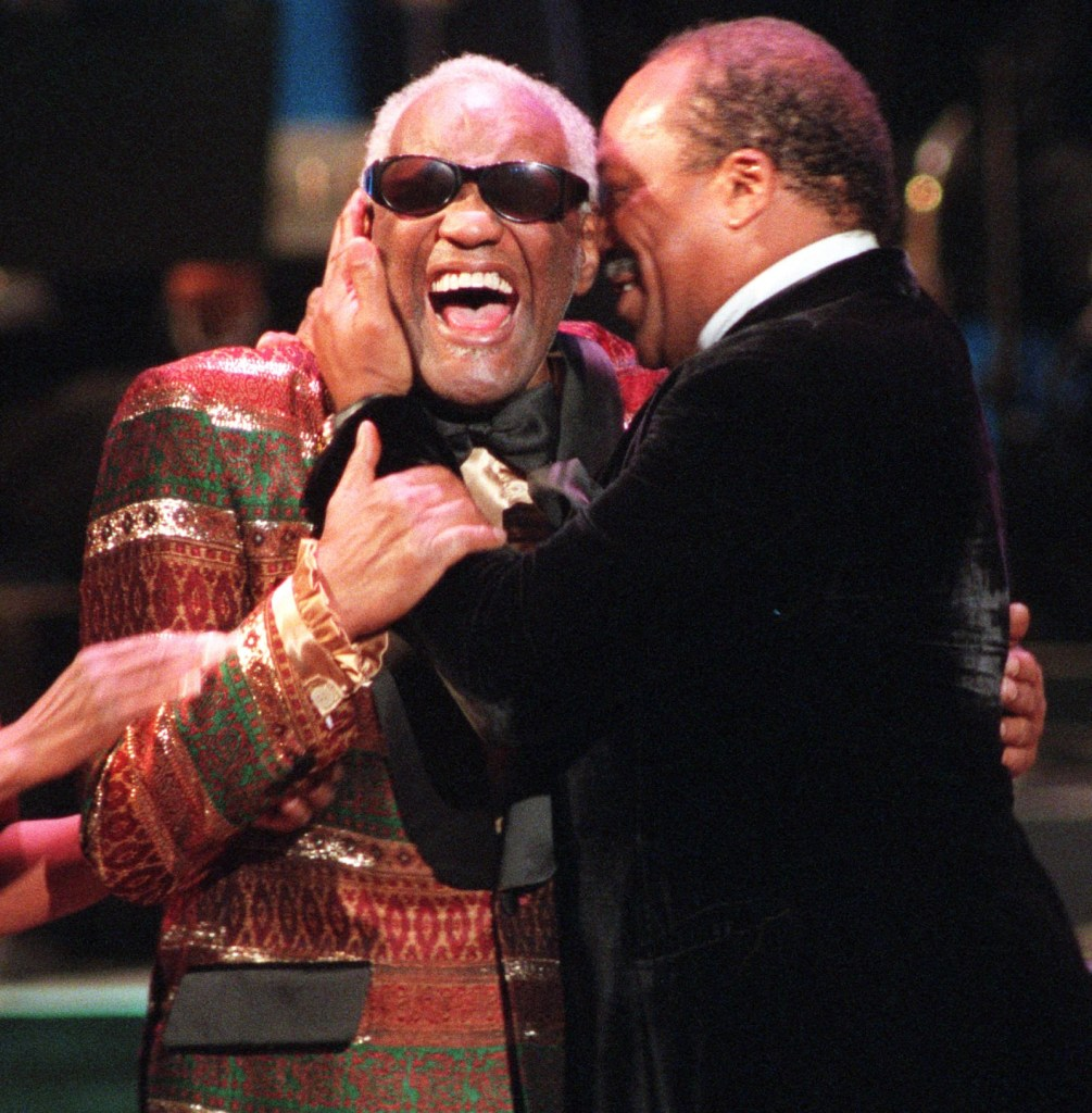 JONES CHARLES Quincy Jones, right, kisses long time friend Ray Charles after receiving his Entertainer of the Year award at the NAACP 27th Image Awards, in Pasadena, CalifIMAGE AWARDS, PASADENA, USA