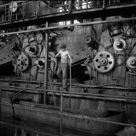 Young Boy Surveying Gears, Usina Sta. Rita, 1992.  Gelatin silver print, 20x24