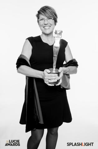 Miriam Romais holding Lifetime Achievement Award for Tsuneko Sasamoto