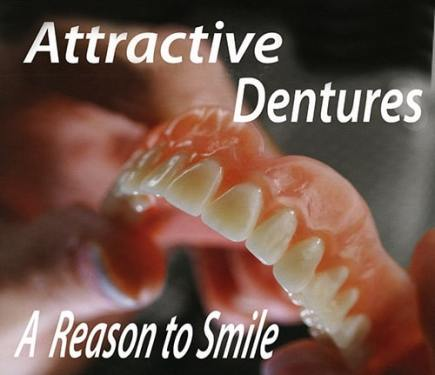 Image of an attractive denture being held by a hand.