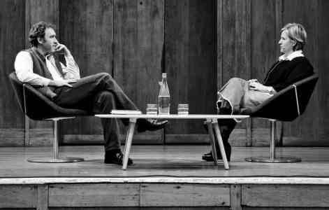 Roman Krznaric and Brene Brown sitting facing each other on stage at the Conway Hall, London on 3 October 2012
