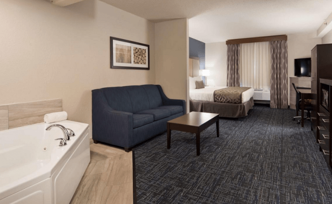 A Jacuzzi suite with Fireplace in Best Western Plus Flint Airport Inn & Suites, Michigan