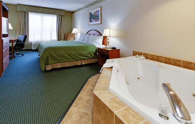 a Whirlpool Suite with a Jacuzzi for two in Country Inn & Suites by Radisson, Brockton Boston, MA