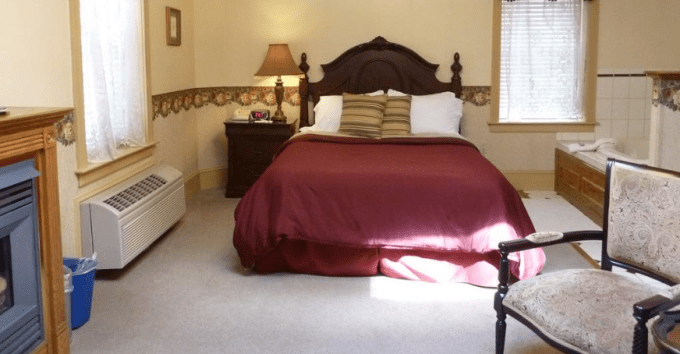 A suite with in room jacuzzi and fireplace in The Inn At Jim Thorpe