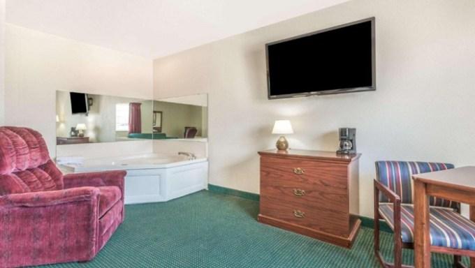 Jacuzzi suite in Super 8 by Wyndham Platte City Kansas City Area