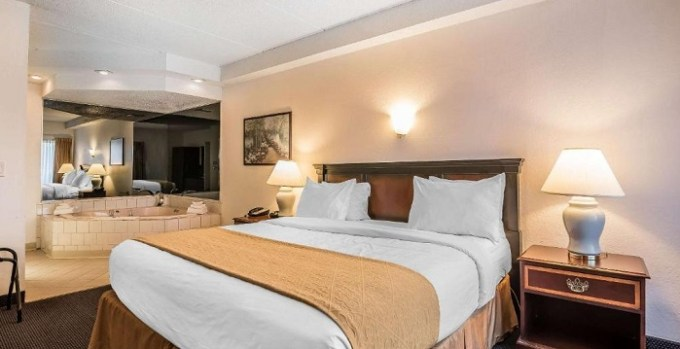 Suite with a hot tub in the bedroom in Quality Inn & Suites Albany Airport, NY