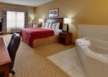 Hot tub suite in Country Inn & Suites by Radisson, Harrisburg at Union Deposit Road, PA