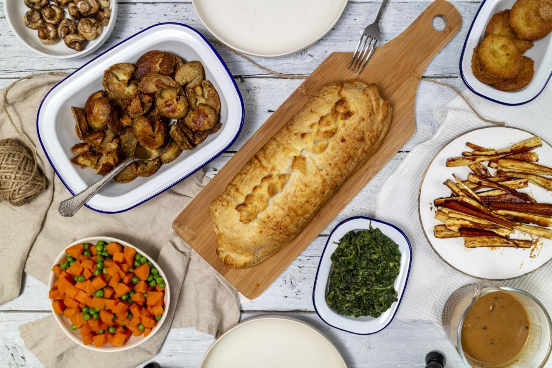 Festive Vegan Seitan Wellington Recipe photographed from above on a festive table setting,