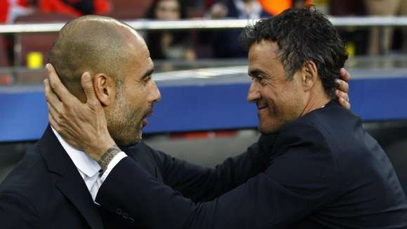 Bayern Munich's Spanish head coach Pep Guardiola (L) and Barcelona's coach Luis Enrique greet each other before the UEFA Champions League football match FC Barcelona vs FC Bayern Muenchen at the Camp Nou stadium in Barcelona on May 6, 2015.     AFP PHOTO/ QUIQUE GARCIA        (Photo credit should read QUIQUE GARCIA/AFP/Getty Images)