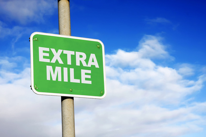Green extra mile sign