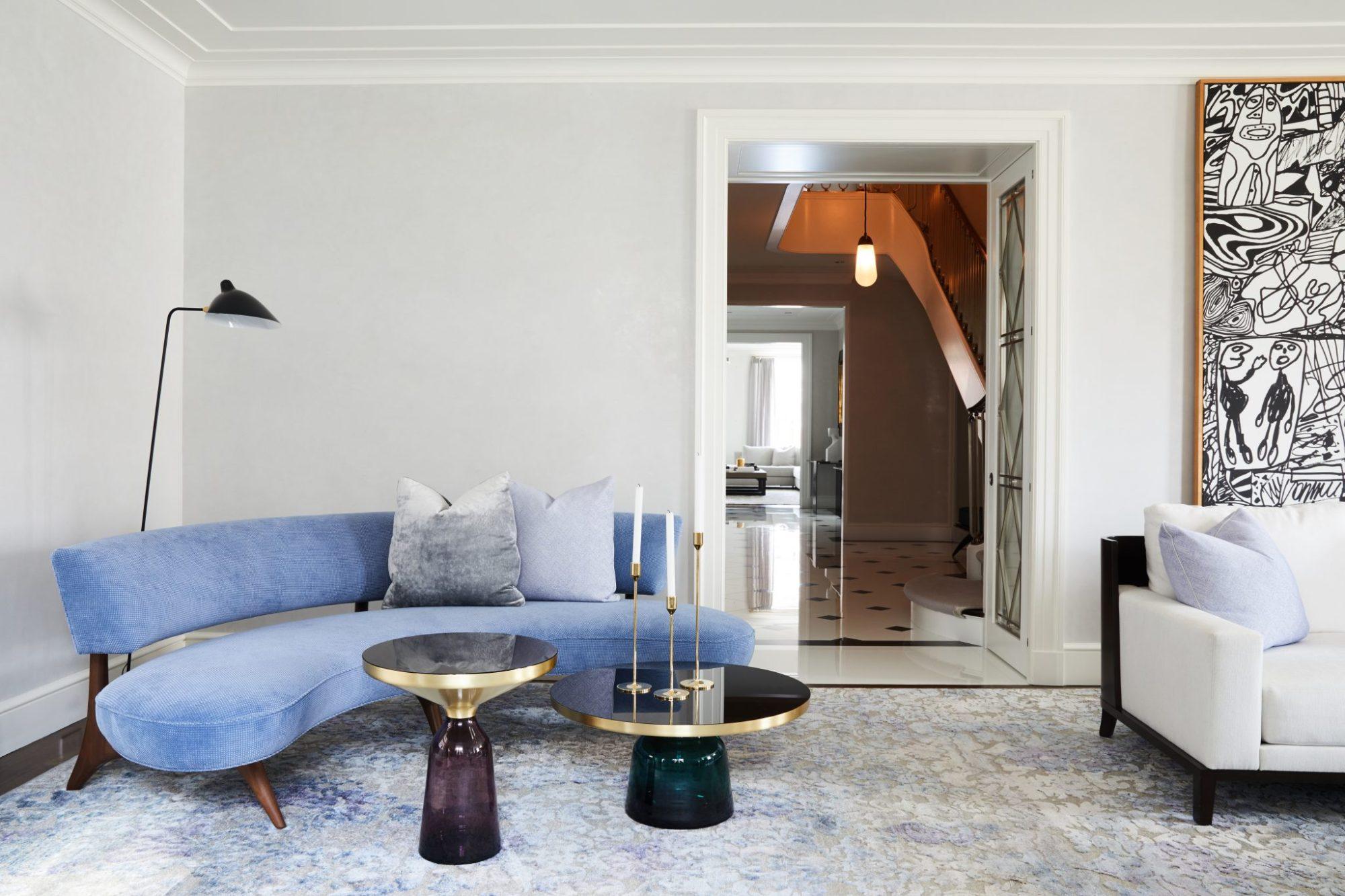 living room with vladimir kagan sofa and serge mouille lighting.