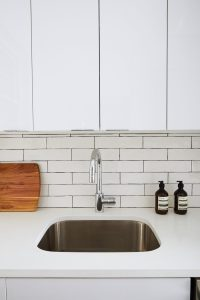 kitchen renovation backsplash subway tile and dark grout