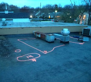 Areas of wet insulation located by roof thermal scan