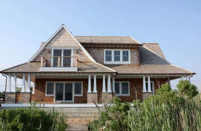 Bonnet Roof on a House with Wood Shingle Siding in Cape Cod, MA