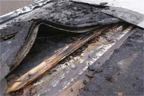 Old, damaged flat roof