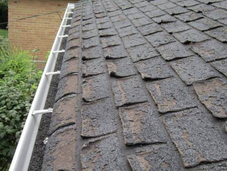 Roof shingle damage from poor ventilation