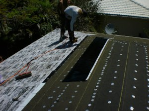 Tile roof underlayment application in Miami by Roofer Mike Inc