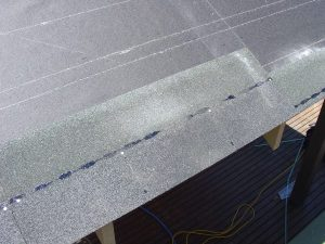 First course of asphalt roof shingles lined up with the starter course