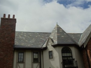 a beautiful slate roof on a house with towers