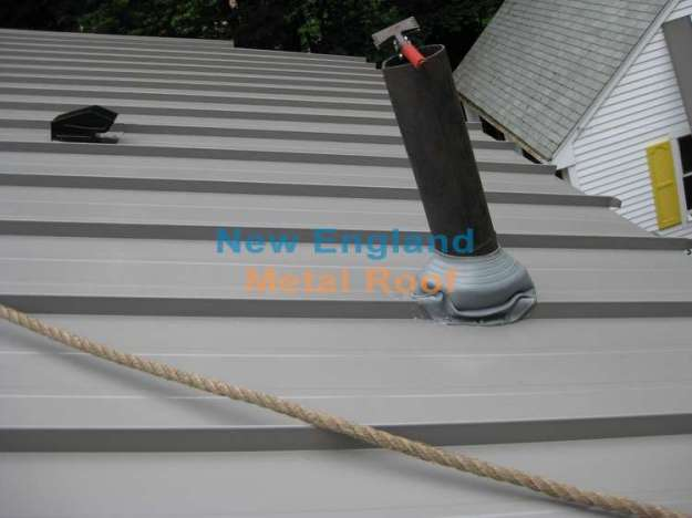 installing a rubber gasket over the roof pipe