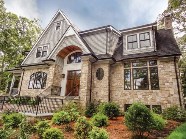 Natural stone siding cost vs stucco and brick veneer for Brick house construction cost