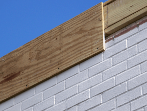 The perimeter wood blocking also was featured at plywood fascia to better stabilize the construction.