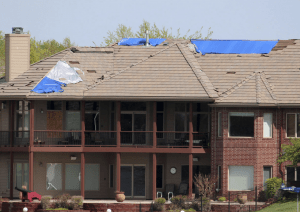 a powerful microburst with winds reaching up to 100 mph destroyed a bulk of the roofs in the subdivision