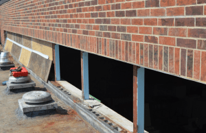PHOTO 4: The clerestory windows at SD 73 Elementary North were removed and revealed concrete masonry units with open cores, which were grouted solid prior to raising the sill.