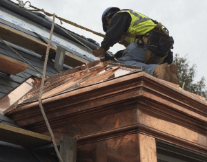 The project included 34 dormers that feature double-lock standing-seam copper and fascia metal.