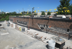 PHOTO 8: The masonry contractor segmented the demolition so the brick above could be supported.