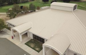 The 238T symmetrical panel system installed on the club house offers wind-uplift resistance and strength characteristics.