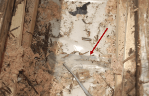 Photo 3: In addition to the polyethylene vapor retarder being inappropriate, it was punctured with recessed lighting and the laps were not sealed.