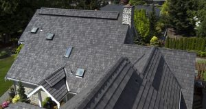 The DaVinci Multi-Width roof, in Mountain Blend, covers the home and attached three-car garage.