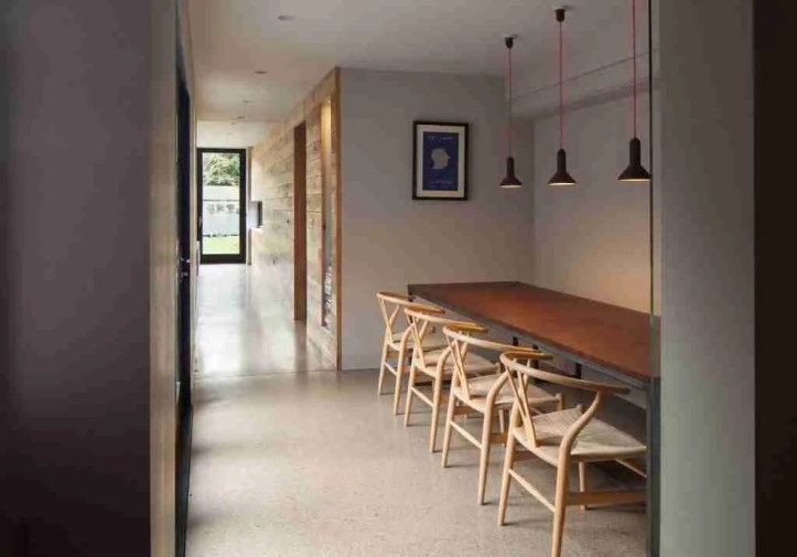Roomy Home concrete interior floor extension dining area link to new extension McCann Moore Architects