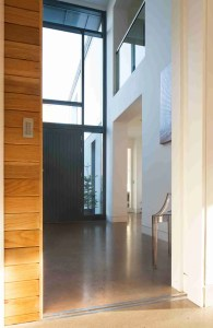 Roomy Home polished concrete interior floor pocket sliding doors into entrance hall McCann Moore Architects
